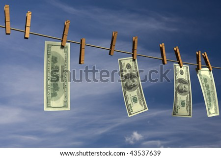 Four hundred dollar bills hanging on a clothesline in front of a cloudy sky