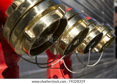 Four hydrants in row with metal background