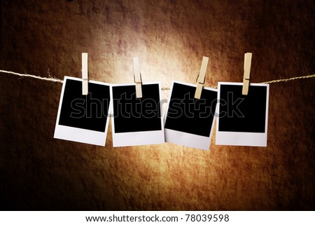Four Instant Photos on a grunge background