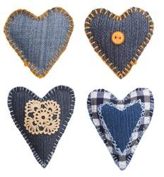 four isolated denim hearts