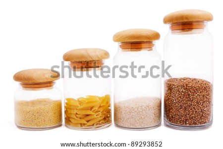 Four jars with different kinds of groats isolated on white - stock photo