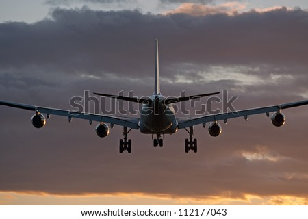 Four jet engine aircraft before landing