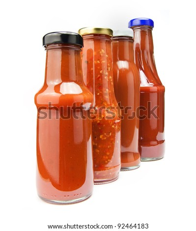 four ketchup bottles isolated on white