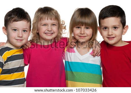 Four kids are standing together; isolated on the white background