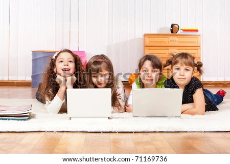 Four little friends with two laptops