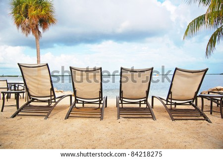 four loungers line the beach front