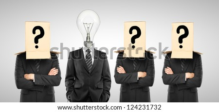 four man with box and lamp on hand