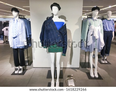 Four mannequins Dressed In Female man Casual Clothes In Store