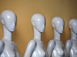 Four Mannequins without dress in a retail shop