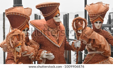 Four masks land at the Piazza San Marco in Venice at Carnival