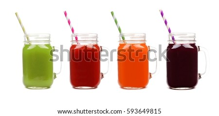 Four mason jar glasses of vegetable juice, greens, tomato, carrot and beet, isolated on a white background