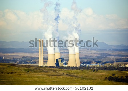 Four massive smoke stacks from a coal fired power station