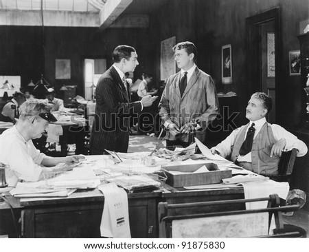 Four men at an office