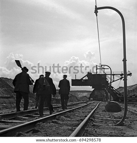 Four men working on railroad tracks