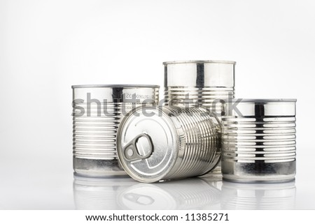 Four metallic tins of canned food isolated