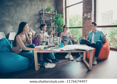 Four minded marketers, smart, clever, intelligent, adorable, stylish people, attractive beautiful nice charming girls and nerd guys talking about project development, gathering, meeting