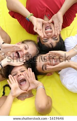 four mixed race kids shouting