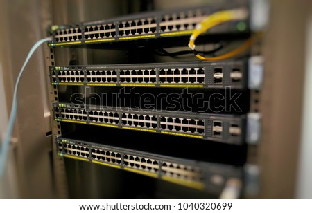 Four Network Switch are mount in rack before config to operation - Shutterstock ID 1040320699