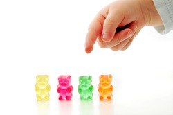 Four of colorfoul gummy bears on white background