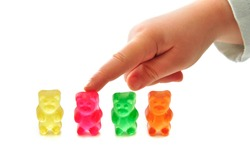 Four of colorful gummy bears on white background