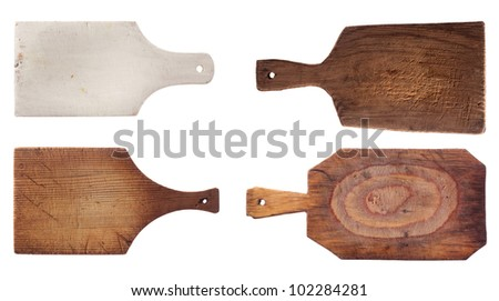 four old used chopping kitchen boards, isolated over white