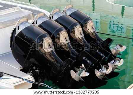 Four outboard motors on a speedboat #1382779205