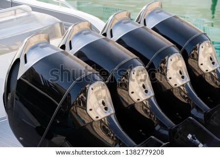 Four outboard motors on a speedboat #1382779208