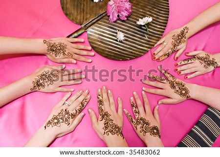 Four pairs of hands with traditional henna deisgns
