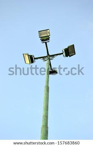 four park light poles with sky backgrounds