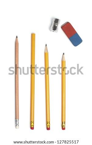 Four pencils with a sharpener and eraser rubber, isolated on white background