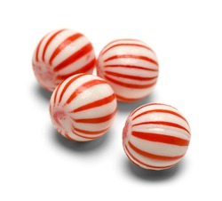 Four Peppermint Balls Isolated on White Background.