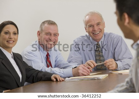 Four person business team in meeting