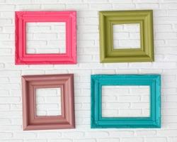 four photo frames on the white wall