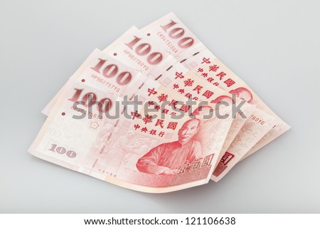 four  piece of one hundred dollar of  New Taiwan Dollar cash close up with  gray background