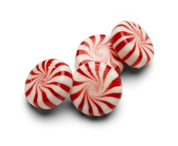 Four Pieces of Peppermint Candy With Swirls Isolated on White Background.