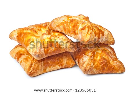 four pies from flaky pastry on a white background