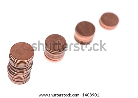 Four piles with cent coins. Focus on the first pile. Ideally white background.