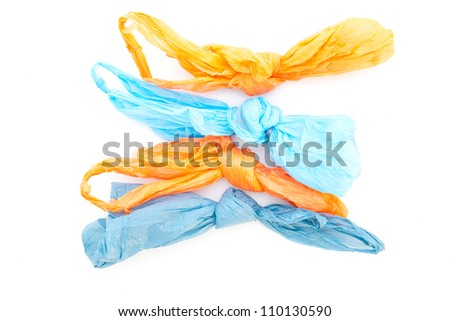 Four plastic bags on a white background