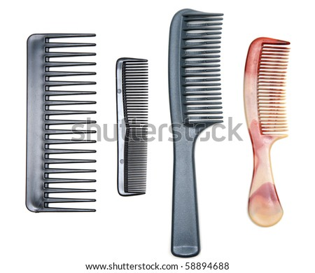 Four plastic combs insulated on white background