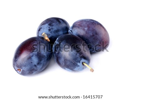 Four plums on white background