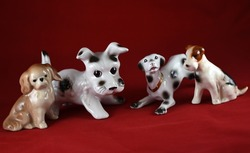 four porcelain dogs  on a red background