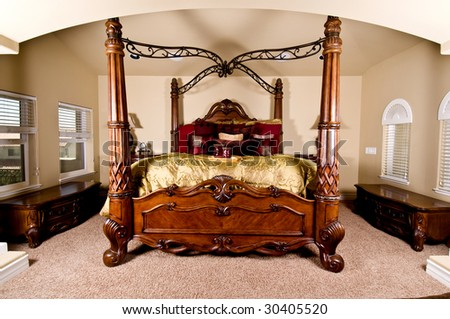 Four poster bed in a luxurious master bedroom