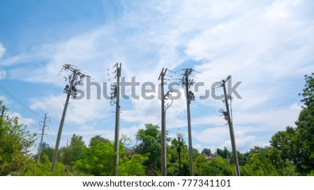 four powerlines near the woods #777341101