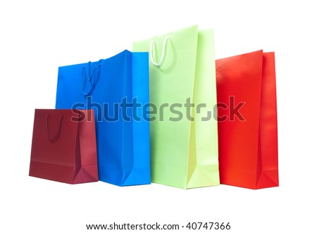 Four present bags in different colors on white background