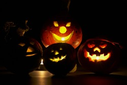 four pumpkins with candle light,studio-shot