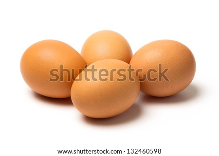 Four raw brown eggs with shadow and isolated on a white background