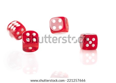 Four  red bouncing dice isolated on white background with reflection #221257666
