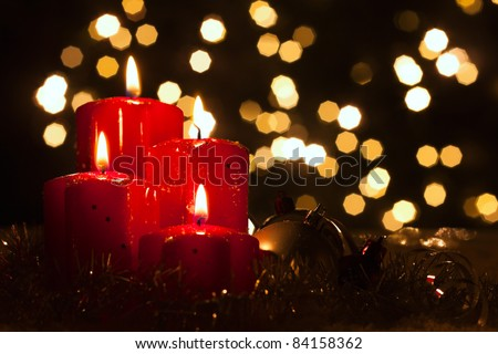 four red candles with christmas balls in atmospheric light #84158362
