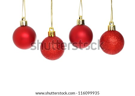 Four red Christmas baubles isolated against white