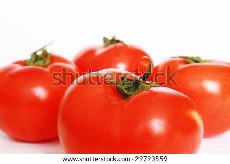 Four red tomatoes isolated. White background